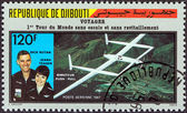 DJIBOUTI - CIRCA 1987: A stamp printed in Djibouti issued for the first flight around the world without stopping or refueling by Rutan Model 76 Voyager shows Dick Rutan and Jeana Yeager, circa 1987. — Stock Photo