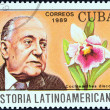 "CUBA - CIRCA 1989: A stamp printed in Cuba from the ""Latin American History (4th series)"" issue shows Alejo Carpentier and Cochleanthes discolor (Cuba), circa 1989. — Stock Photo"