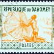 "DAHOMEY - CIRCA 1961: A stamp printed in Dahomey from the ""Artisans"" issue shows Fisherman casting net, circa 1961. — Stock Photo"