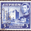 Stock Photo: CYPRUS - CIRC1938: stamp printed in Cyprus shows Kolossi Castle and King George VI, circ1938.