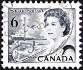 CANADA - CIRCA 1967: A stamp printed in Canada shows Queen Elizabeth II and transportation, circa 1967. — Stock Photo