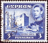 CYPRUS - CIRCA 1938: A stamp printed in Cyprus shows Kolossi Castle and King George VI, circa 1938. — Stock Photo
