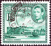 CYPRUS - CIRCA 1938: A stamp printed in Cyprus shows Kyrenia Harbor and King George VI, circa 1938. — Stock Photo