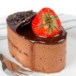 Stock Photo: Small chocolate cake with strawberry isolated