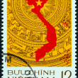 Stock Photo: VIETNAM - CIRC1976: stamp printed in North Vietnam issued for Reunification of Vietnam shows map on bronze drum pattern, symbol of culture of Vietnam, circ1976.