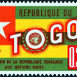 Stock Photo: TOGO - CIRC1961: stamp printed in Togo issued for Admission of Togo into U.N shows Togo Flag, circ1961.