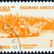 CUBA - CIRCA 1982: A stamp printed in Cuba from the Exports issue shows agricultural machinery, circa 1982.  — Stock Photo
