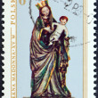 POLAND - CIRCA 1976: A stamp printed in Poland from the Polish Art issue shows Madonna and Child (painted carving, 1410), circa 1976.  — Stock Photo