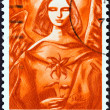"ICELAND - CIRCA 1984: A stamp printed in Iceland from the ""Christmas "" issue shows Angel with Christmas rose, circa 1984. — Stock Photo #35895963"