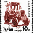 NORTH KOREA - CIRCA 1995: A stamp printed in North Korea from the Machines  issue shows Chollima 80 tractor, circa 1995. — Stock Photo