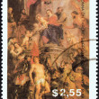"GUYANA - CIRCA 1989: A stamp printed in Guyana from the ""Christmas. Paintings"" issue shows Madonna Enthroned, surrounded by Saints (Rubens), circa 1989. — Stock Photo"