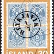 ICELAND - CIRC1976: stamp printed in Iceland issued for centenary of Icelandic Aurar Currency Stamps shows Iceland 5a, stamp with Reykjavik Postmark, 1876, circ1976. — Stock Photo #35896483