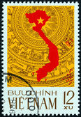 VIETNAM - CIRCA 1976: A stamp printed in North Vietnam issued for the Reunification of Vietnam shows map on the bronze drum pattern, a symbol of the culture of Vietnam, circa 1976. — Stock Photo