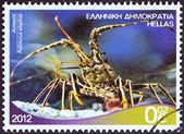"GREECE - CIRCA 2012: A stamp printed in Greece from the ""Riches of the Greek Seas"" issue shows a Spiny Lobster (Palinurus elephas), circa 2012. — Stock Photo"