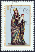 """POLAND - CIRCA 1976: A stamp printed in Poland from the """"Polish Art"""" issue shows Madonna and Child (painted carving, 1410), circa 1976. — Stock Photo"""