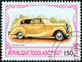 "TOGO - CIRCA 1999: A stamp printed in Togo from the ""Antique Automobiles"" issue shows a Rolls-Royce Silver Wraith, 1950, circa 1999. — Stock Photo"