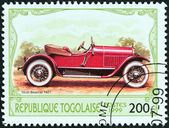 "TOGO - CIRCA 1999: A stamp printed in Togo from the ""Antique Automobiles"" issue shows a Stutz Bearcat, 1921, circa 1999. — Stock Photo"