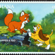 "GHANA - CIRCA 1996: A stamp printed in Ghana from the ""1996 National Stamp Exhibition, Orlando, USA - Disney Friends - Disney Cartoon Characters "" issue shows Copper and Tod, circa 1996. — Stock Photo"