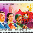 NORTH KOREA - CIRCA 1981: A stamp printed in North Korea issued for the Seventh League of Socialist Working Youth Congress, Pyongyang shows League Members and Flag, circa 1981. — Stock Photo