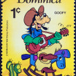 "Stock Photo: DOMINICA - CIRCA 1979: A stamp printed in Dominica from the ""International Year of the Child. Walt Disney Cartoon Characters "" issue shows Goofy playing guitar, circa 1979."