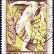 "GREECE - CIRCA 1953: A stamp printed in Greece from the ""National Products"" issue shows Grapes (God Dionysus holding grapes), circa 1953. — Stock Photo"