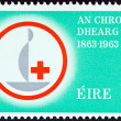 Stock Photo: IRELAND - CIRC1963: stamp printed in Ireland issued for Centenary of Red Cross shows Centenary Emblem, circ1963.