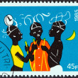 "BURKINA FASO - CIRCA 1985: A stamp printed in Burkina Faso from the ""Dodo Carnival"" issue shows three dancers, circa 1985. — Stock Photo"