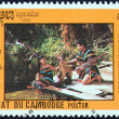 "Stock Photo: CAMBODI- CIRC1992: stamp printed in Cambodifrom ""Environmental Protection "" issue shows couple on riverside, circ1992."