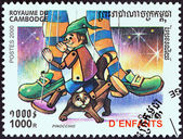 "CAMBODIA - CIRCA 2000: A stamp printed in Cambodia from the ""Children stories"" issue shows Pinocchio, circa 2000. — Stock Photo"