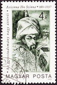 "HUNGARY - CIRCA 1987: A stamp printed in Hungary from the ""Pioneers of Medicine (1st series) "" issue shows Avicenna (Kanun book of medical rules), circa 1987. — Stock Photo"
