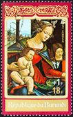 """BURUNDI - CIRCA 1972: A stamp printed in Burundi from the """"Christmas """" issue shows Madonna and Child (Sebastiano Mainardi), circa 1972. — Stock Photo"""