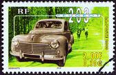 """France - vers 2000 : un timbre imprimé en france de la """"philexjeunes 2000"""" question montre peugeot 203, circa 2000. — Photo"""