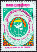 KAMPUCHEA - CIRCA 1984: A stamp printed in Kampuchea issued for the International Peace in South-East Asia Forum, Phnom Penh shows Doves and Globe, circa 1984. — Stock Photo
