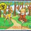 EQUATORIAL GUINEA - CIRCA 1979: A stamp printed in Equatorial Guinea issued for the International Year of the Child shows child and fawn, circa 1979. — Stock Photo