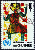 "GUINEA - CIRCA 1966: A stamp printed in Guinea from the ""The 20th Anniversary of UNICEF "" issue shows Child in the garden (children drawing), circa 1966. — Zdjęcie stockowe"
