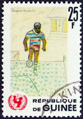"GUINEA - CIRCA 1966: A stamp printed in Guinea from the ""The 20th Anniversary of UNICEF "" issue shows footballer (children drawing), circa 1966. — Zdjęcie stockowe"