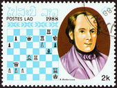 "LAOS - CIRCA 1988: A stamp printed in Laos from the ""Chess Masters "" issue shows Adolf Anderssen, circa 1988. — Foto de Stock"