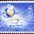 "SOUTH AFRICA - CIRCA 1961: A stamp printed in South Africa from the ""Republic "" issue shows Pouring gold, circa 1961. — Stock Photo"