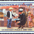 "GUERNSEY - CIRCA 1980: A stamp printed in United Kingdom from the ""60th Anniversary of Guernsey Police Force"" issue shows policewoman with lost child, circa 1980. — Stock Photo"