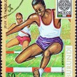 "BURUNDI - CIRCA 1968: A stamp printed in Burundi from the ""19th Olympic Games, Mexico City"" issue shows 400m hurdles race, circa 1968. — Stock Photo #42500961"