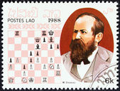 "LAOS - CIRCA 1988: A stamp printed in Laos from the ""Chess Masters "" issue shows Wilhelm Steinitz, circa 1988. — Stock Photo"