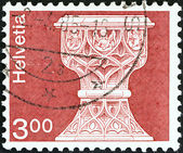 SWITZERLAND - CIRCA 1973: A stamp printed in Switzerland shows font, St. Maurice church, Saanen, circa 1973. — Стоковое фото