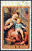 "BURUNDI - CIRCA 1976: A stamp printed in Burundi from the ""Christmas "" issue shows Virgin with Basket (Correggio), circa 1976. — Stock Photo"