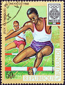 "BURUNDI - CIRCA 1968: A stamp printed in Burundi from the ""19th Olympic Games, Mexico City"" issue shows 400m hurdles race, circa 1968. — Stock Photo"