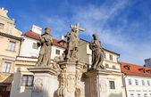 Statue of the Holy Savior with Cosmas and Damian on Charles Bridge, Prague, Czech Republic. — Stock Photo