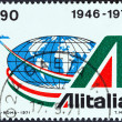 ITALY - CIRCA 1971: A stamp printed in Italy from the issued for the 25th anniversary of Alitalia State Airline shows emblem and globe, circa 1971. — Stock Photo #42943269