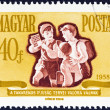 "HUNGARY - CIRCA 1958: A stamp printed in Hungary from the ""Savings Campaign "" issue shows schoolboys with savings stamps, circa 1958. — Foto Stock"