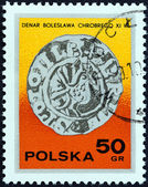 """POLAND - CIRCA 1977: A stamp printed in Poland from the """"Stamp Day. Polish Coins """" issue shows Silver Dinar (11th century), circa 1977. — Stock Photo"""