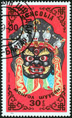 "MONGOLIA - CIRCA 1984: A stamp printed in Mongolia from the ""Traditional Masks "" issue shows god Zamandi mask, circa 1984. — Stock Photo"
