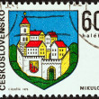 "CZECHOSLOVAKIA - CIRCA 1973: A stamp printed in Czechoslovakia from the ""Arms of Czech Regional Capitals (4th series)"" issue shows coat of arms of Mikulov town, circa 1973. — Stock Photo"